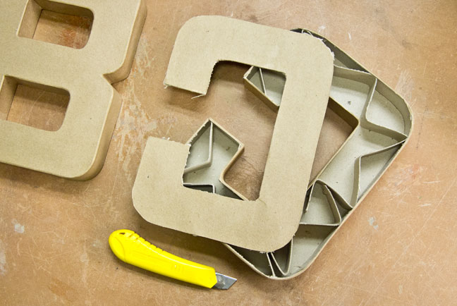 out the cardboard structure inside the number make sure to cut the back of the letter off this way the face of the letter you cast will be smooth